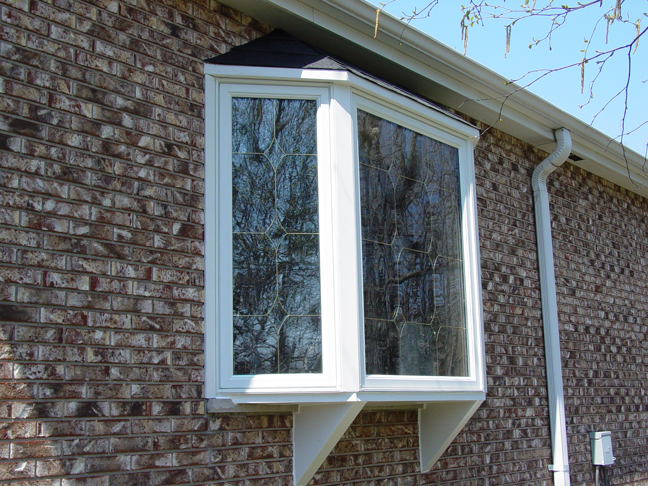 Bay window exterior 1 quality window specialists inc for Quality windows